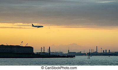 Commercial plane flying into Logan Airport - A commercail...