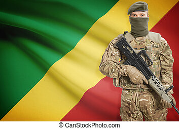 Soldier holding machine gun with flag on background series -...