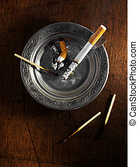 Ashtray - Decorated silver ashtray with cigarette butts and...