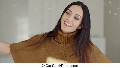 Happy vivacious young woman indoors at home