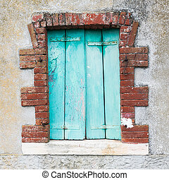 Window of a farmhouse with red brick frame. - Window of a...