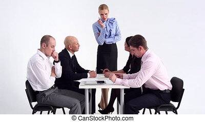 Stress in the Workplace - Business team discussing the...