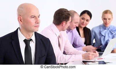 Successful business team - Businessman and his team looking...