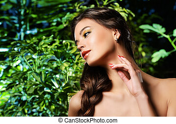 gentle touch - Beautiful young woman on a background of...