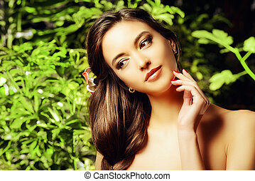 skincare - Beautiful young woman on a background of green...