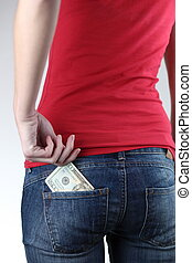 Closeup of woman\'s bottom with banknotes in the pocket (she...