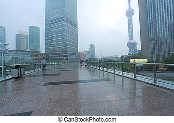 Empty marble floor road with modern city architecture...