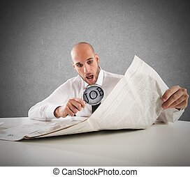 Unexpected jobs - Businessman reading the newspaper with...