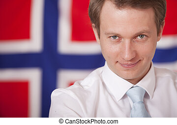 businessman over norwegian flag - businessman posing in...