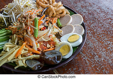 Green papaya salad Som Tum with Pickled crab