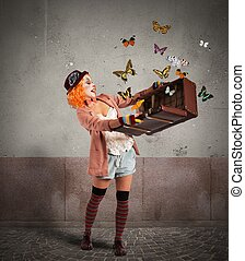Magic suitcase - Clown opens a suitcase which emerges...