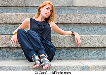 beautiful woman 30 years old sitting on the steps