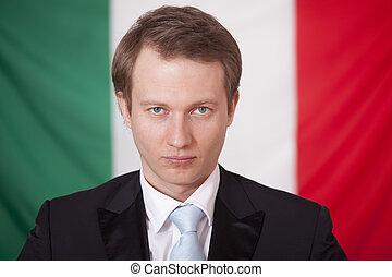 serious businessman over italian flag