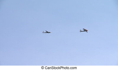 Glider on trailer at single-engine aircraft - View of glider...