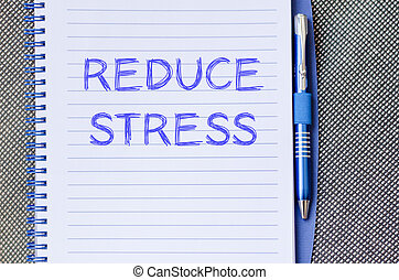 Reduce stress write on notebook - Reduce stress text concept...