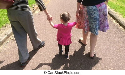 Little girl walks - Little girl 1-2 years old walks with her...