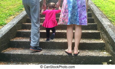 Little girl climb up stairs - Little girl (1-2 years old)...