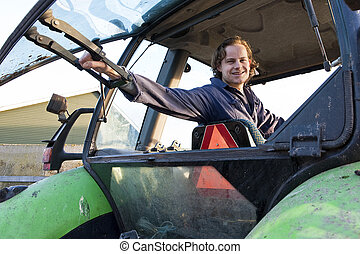 Farm hand in a tractor - Farm hand looking out the rear...