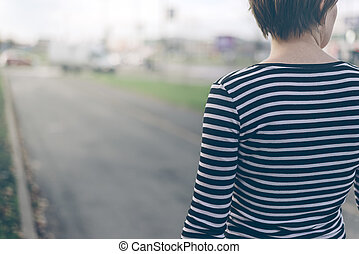 Ordinary woman walking down the street - Ordinary woman from...