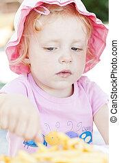 little girl eating chips