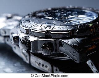 Wet wrist watch - Closeup of wet metal wrist watch.