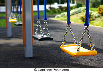 Empty Swing - Empty playground swings in a row