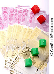 Home Purchase - several notes and houses symbolizing the...