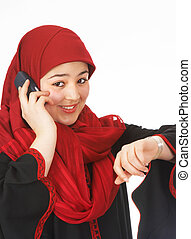 Phone call just in time - Young islamic woman making a phone...