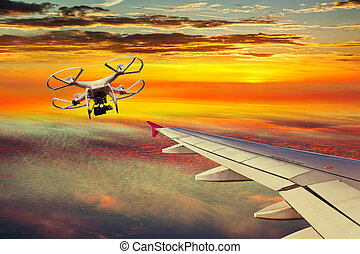 Collision course - The small drone and plane on a collision...