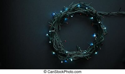 Christmas lamp garland motion on a black background - Circle...