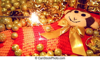 Christmas sock with monkey and sparkler on gold and red blur...