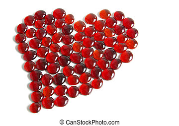 Heart Shape - Photo of tens of little red glass gems forming...