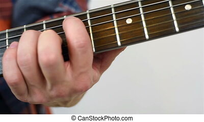 Man Playing On A Electric Guitar, Close Up