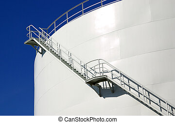 Oil Silo - White industrial oil container with stairs in a...