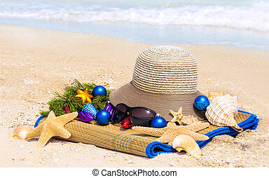 New year on the beach - Christmas balls, hat, shells,...