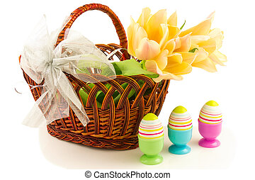 Easter eggs, tulips in basket with bow