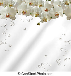 orchids scattered on silk with jewelled hearts