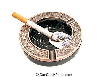 cigarette and portrait of child in ashtray - cigarette and...