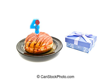donut with four years birthday candle and gift on white