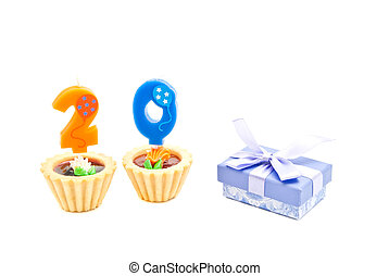 cakes with twenty years birthday candles and gift on white