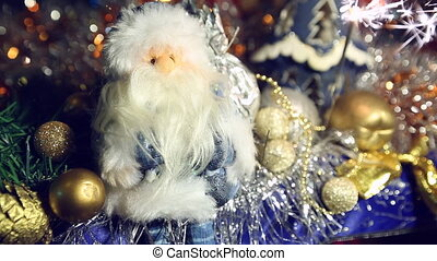 Christmas sparkler and Santa Claus close-up on blue and...