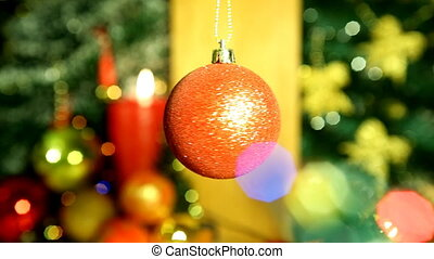 Christmas ball spinning against christmas blur background of...