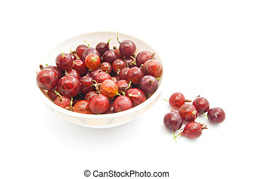 tasty gooseberries on a dish - tasty red gooseberries on a...