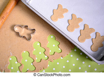 Preparing christmas cookies with different shapes