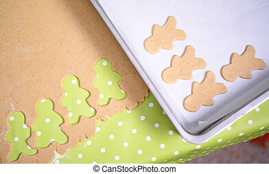 Preparing christmas cookies with gingerbread  shapes