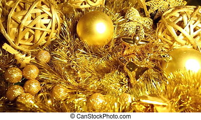 In tinsel and Christmas balls of gold tone the box with a...