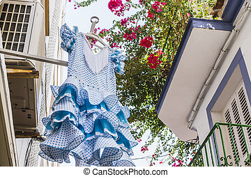 typical flamenco dresses in Marbella Andalucia Spain