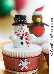 Christmas cupcakes decorated with a snowman and robin