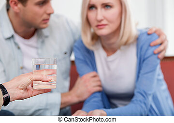 Young husband and wife are consulting marriage therapist -...