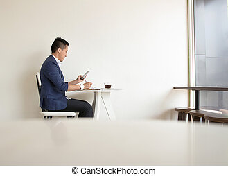 Asian casual business man working in coffee shop